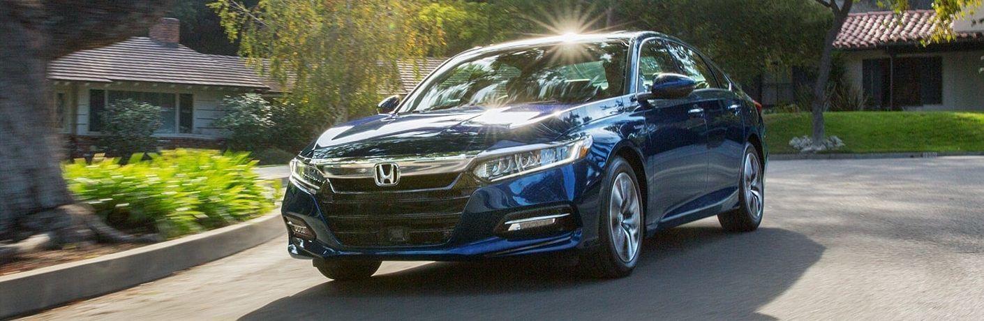Blue 2021 Honda Accord Hybrid in suburban area