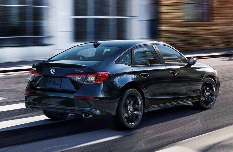 2022 Honda Civic zooms over a crosswalk