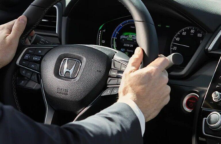 Man grips steering wheel of 2022 Honda Insight