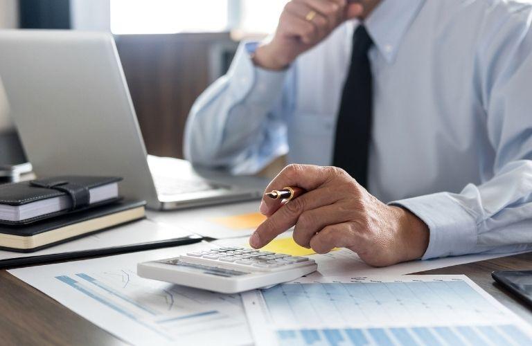 A man calculating on a calculator