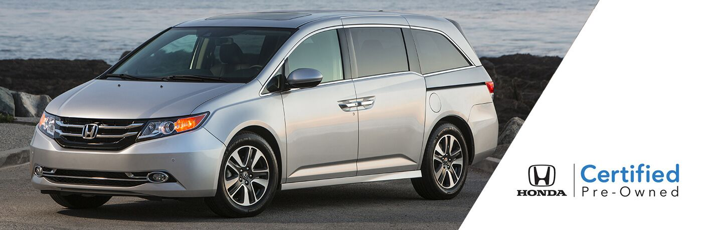 """Silver Honda Odyssey next to text that reads, """"Honda Certified Pre-Owned"""""""