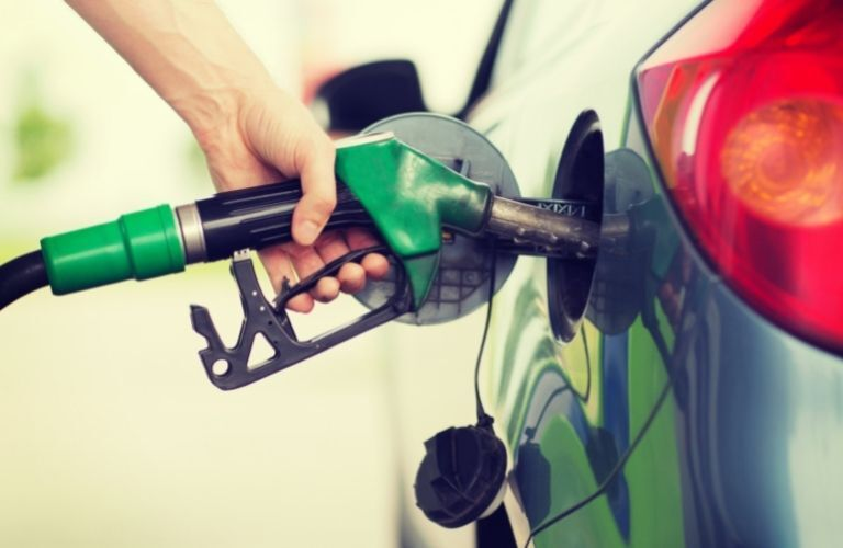 Fuel being pumped into a car