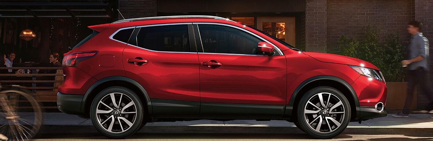 side view of a red 2018 Nissan Rogue Sport
