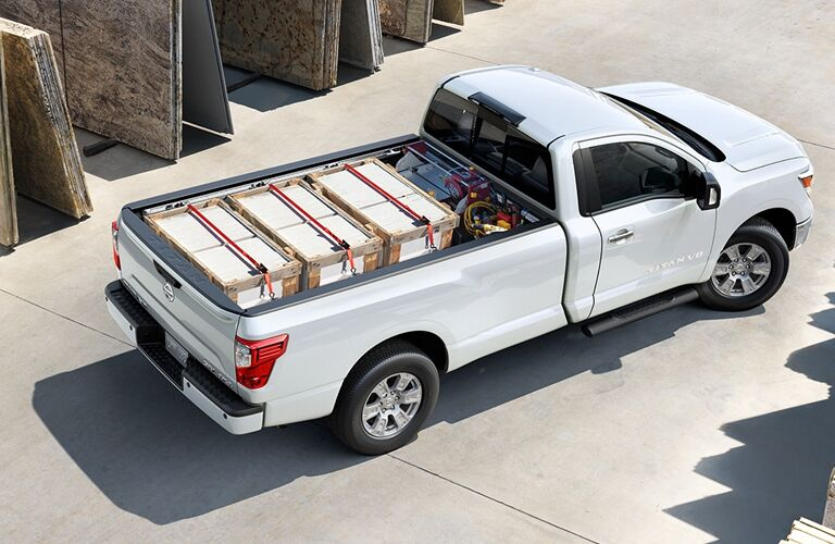high angle view of a white 2018 Nissan TITAN with a full truck bed