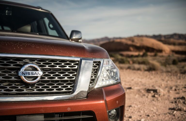 close up of the front exterior of a red 2019 Nissan Armada