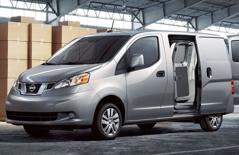 side view of a silver 2019 Nissan NV200