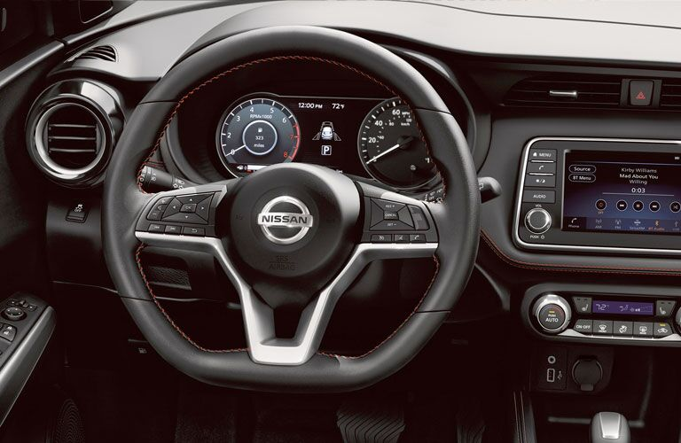 Interior front steering wheel and dash in a 2020 Nissan Kicks