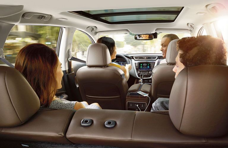 Happy family seen from behind inside a 2020 Nissan Murano