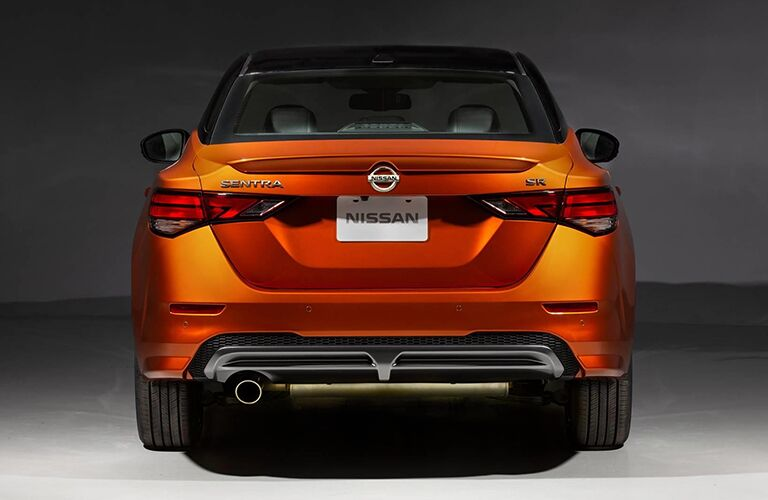 Rear view of a 2020 Nissan Sentra in orange color