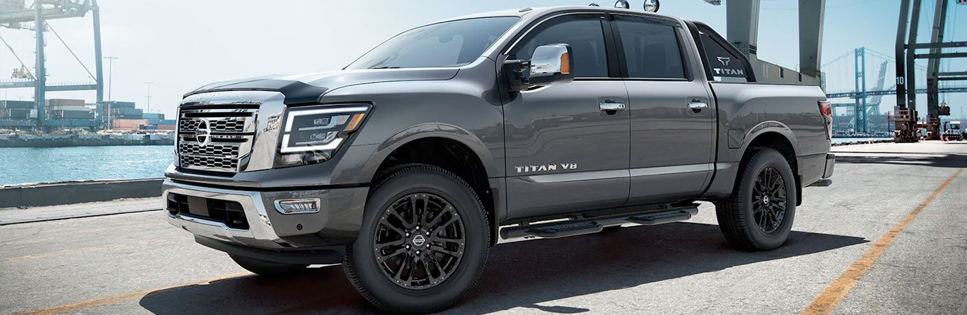 Silver 2020 Nissan TITAN parked at a harbor