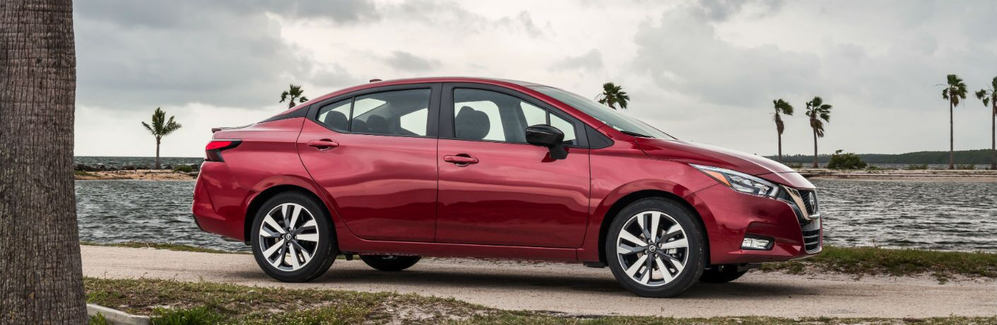 side view of a red 2020 Nissan Versa