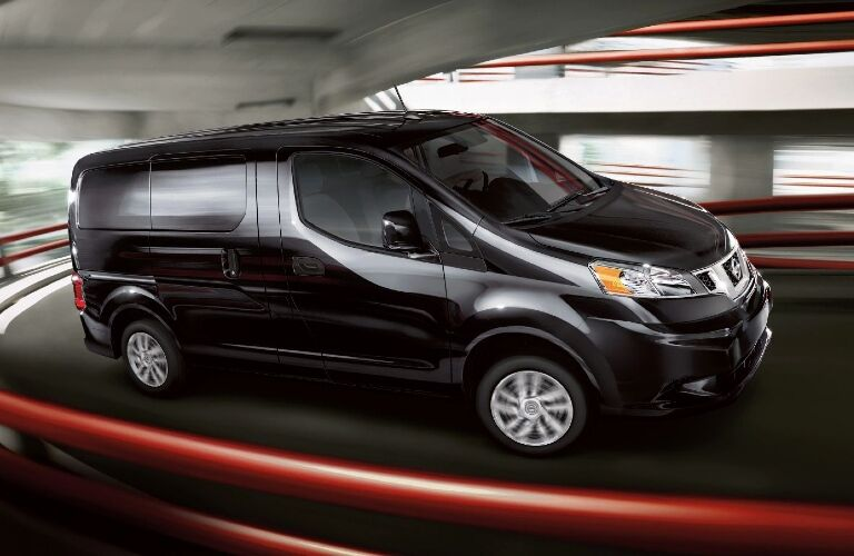 Black 2020 Nissan NV200 zooms up a circular ramp