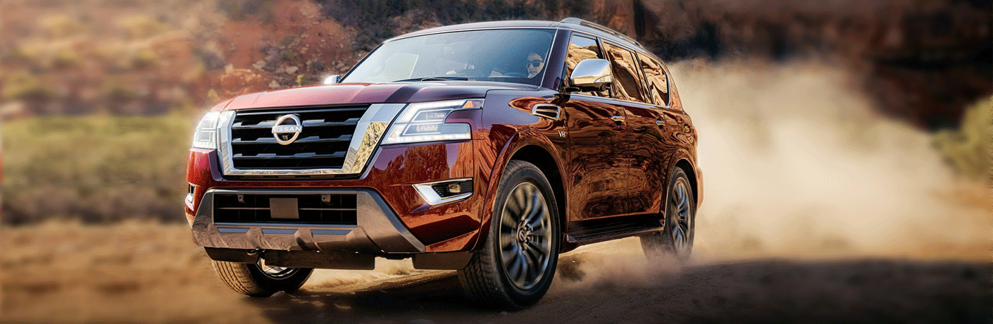 Low-angled view of a 2021 Nissan Armada barreling through dust