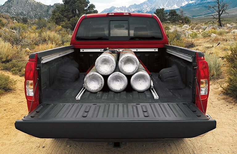 Heavy items loaded in bed of 2021 Nissan Frontier
