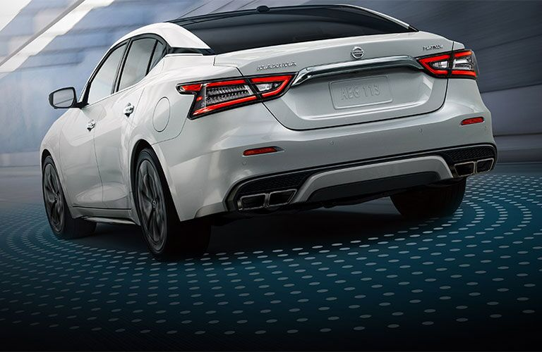 White 2021 Nissan Maxima emits some kind of beam