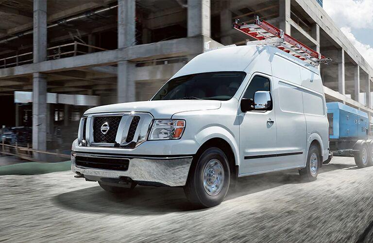 White 2021 Nissan EV Cargo Van with a ladder on it