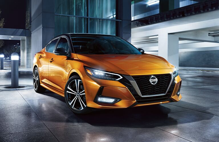 Front/side angled view of yellow 2021 Nissan Sentra