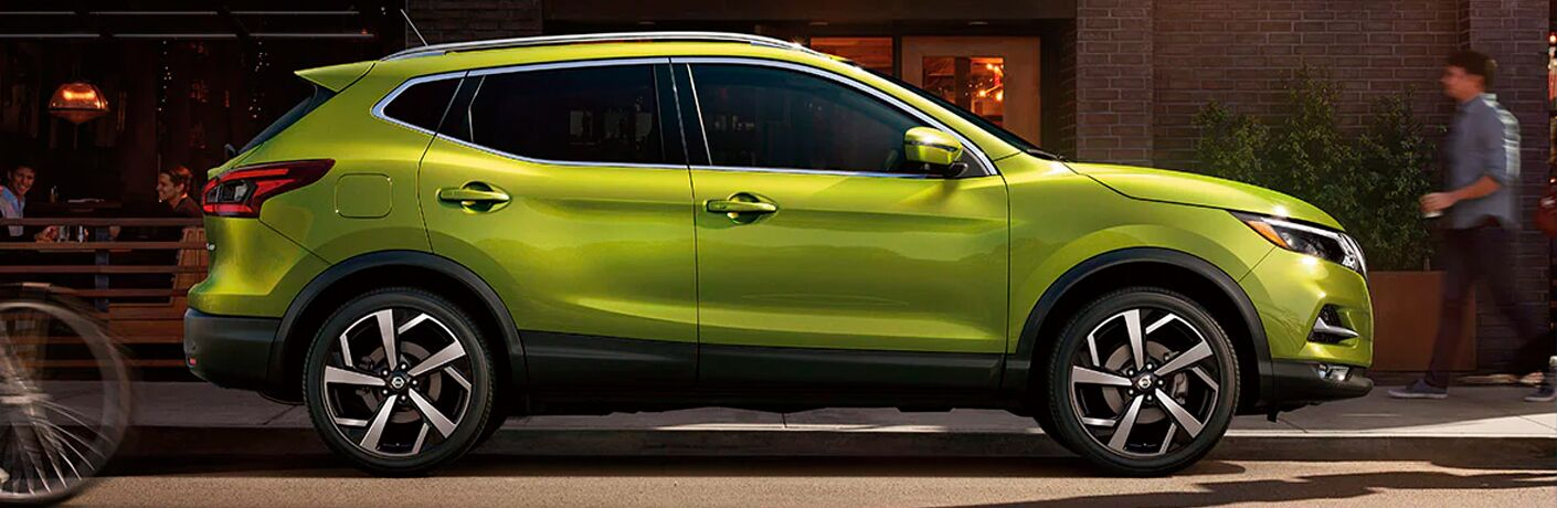Side view of a pea green 2021 Nissan Rogue Sport
