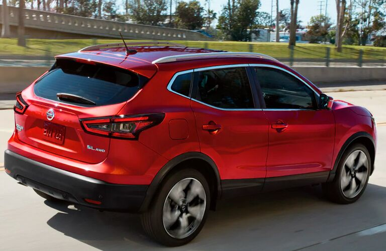 Rear/side raised-angled view of a red 2021 Nissan Rogue Sport