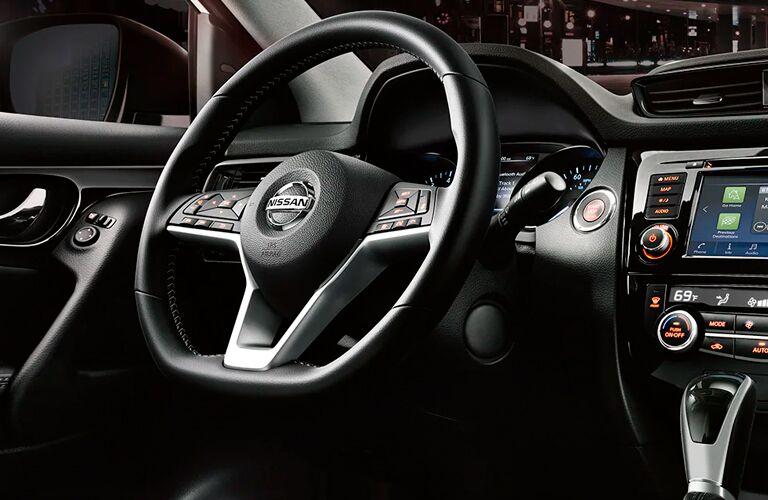Interior front cockpit steering wheel region of a 2021 Nissan Rogue Sport
