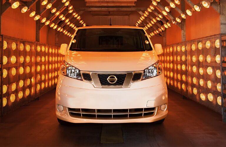 2021 Nissan NV200 in illuminated garage