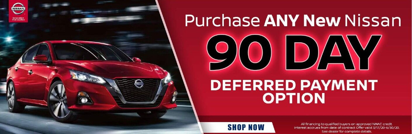 Banner with a nissan model advertises ability to defer payment for 90 days on any new Nissan