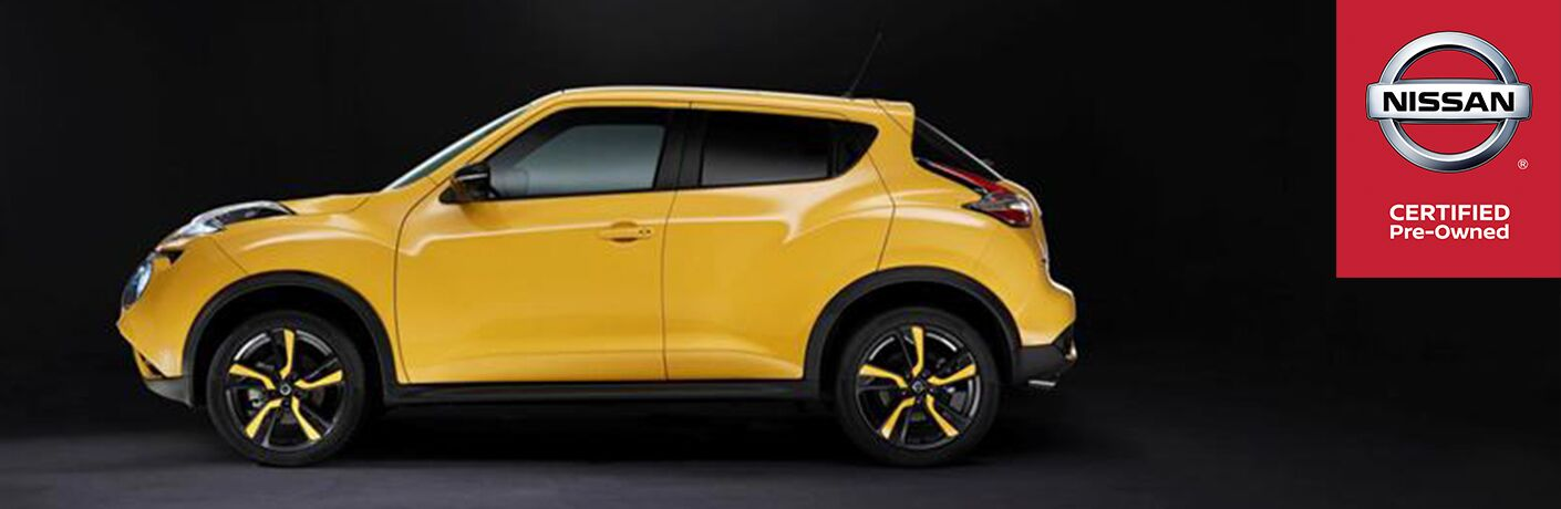 """Side view of a yellow Nissan vehicle on a black background. Text to the right reads, """"Nissan Certified Pre-Owned"""""""