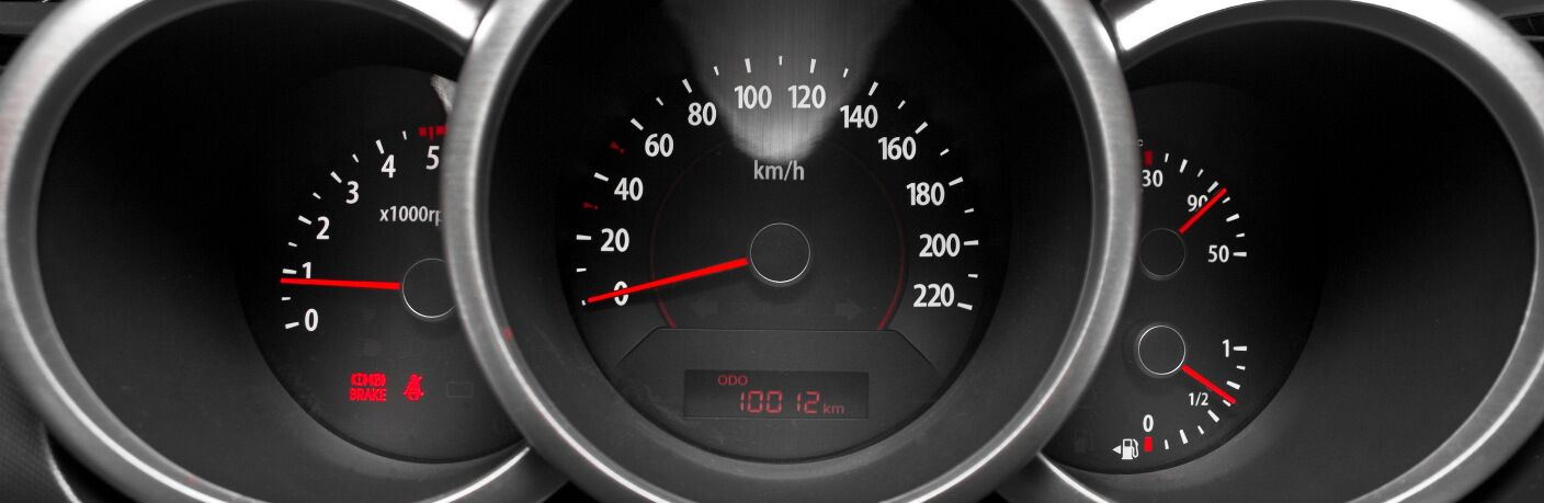 Close up view of three main dashboard dials, including the odometer.