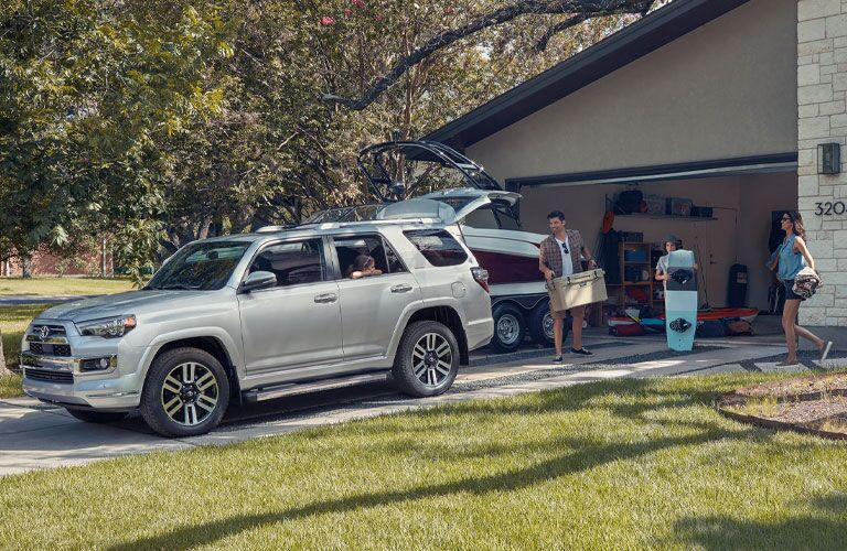 Family loads up the cargo hatch of a silver 2020 Toyota 4Runner