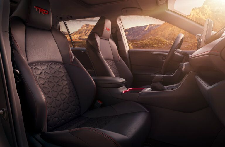 Side view of front seats and steering wheel in a 2020 Toyota RAV4 TRD Pro.