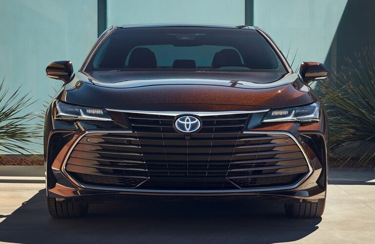 front view of a red 2019 Toyota Avalon Hybrid
