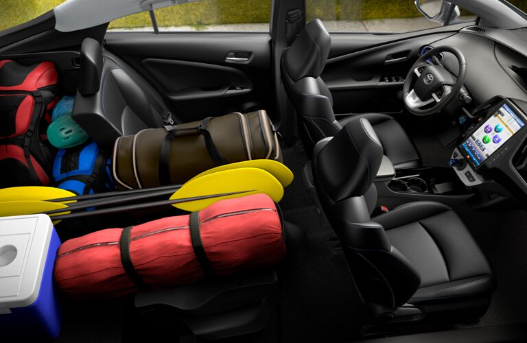 high angle view of the full interior of a 2019 Toyota Prius with the rear full of cargo
