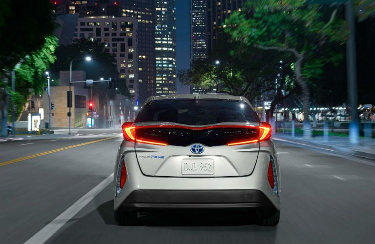 rear view of a tan 2019 Toyota Prius Prime
