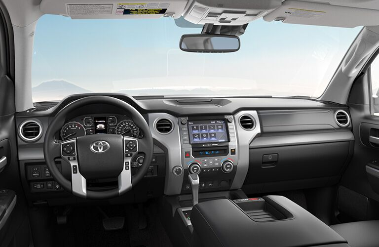 Interior front cabin of a 2020 Toyota Tundra with a view of mountains.