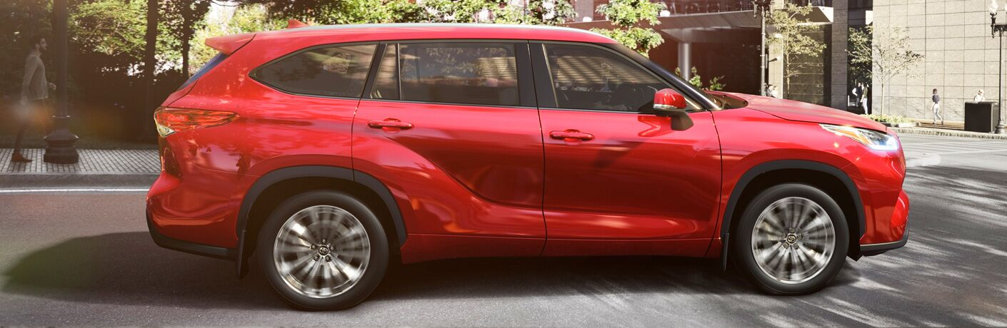 side view of a red 2020 Toyota Highlander Hybrid