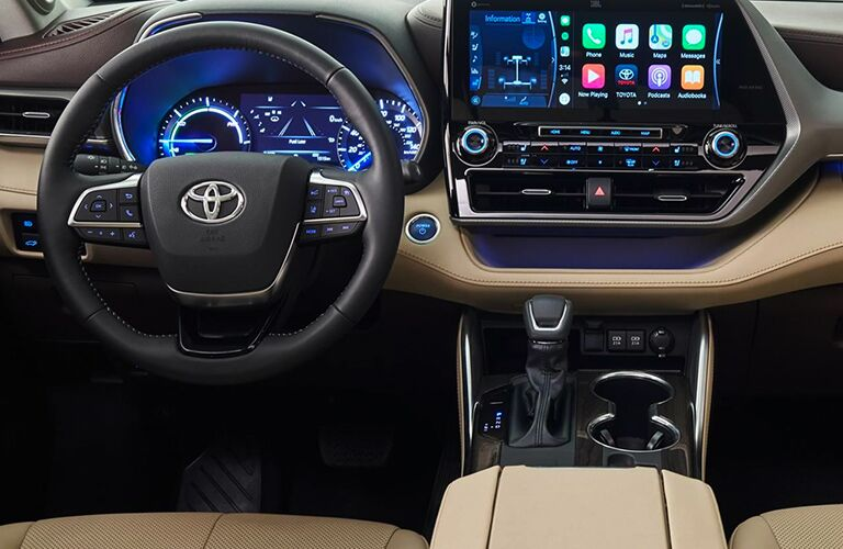 driver dash and infotainment system of a 2020 Toyota Highlander Hybrid