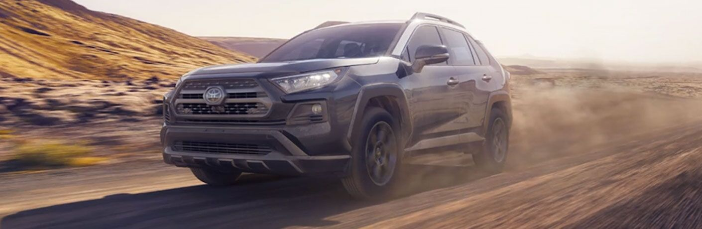2020 Toyota RAV4 TRD Pro drives along a desert path and kicks up dust.