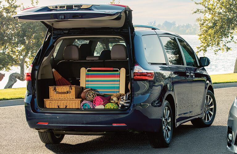 rear view of a 2020 Toyota Sienna with its rear cargo door open and cargo area full