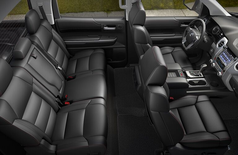 Raised view of the interior front and back seats in a 2020 Toyota Tundra.