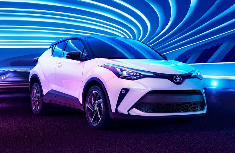 White 2021 Toyota C-HR under swirling blue lights