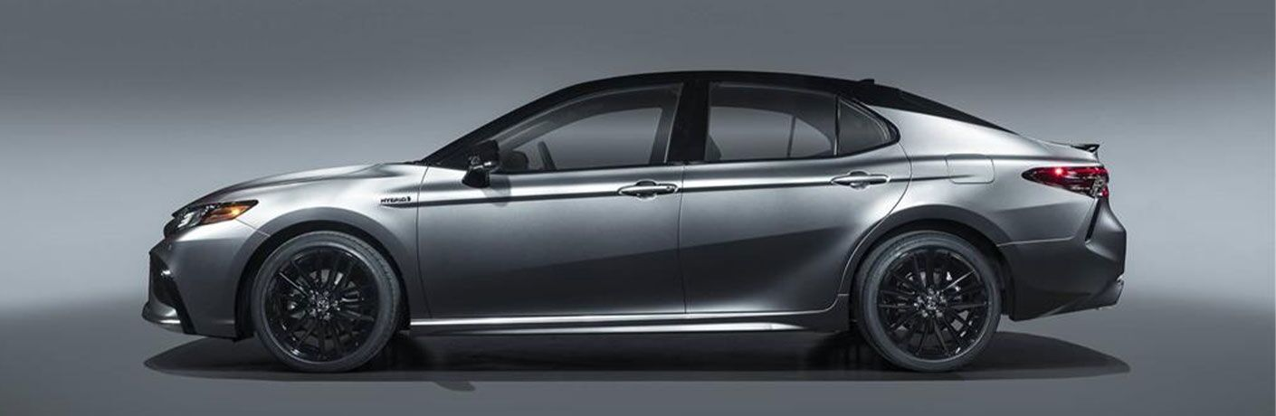 Side view of a silver 2021 Toyota Camry Hybrid