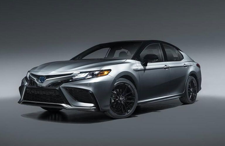 Front/side angled view of a silver 2021 Toyota Camry Hybrid