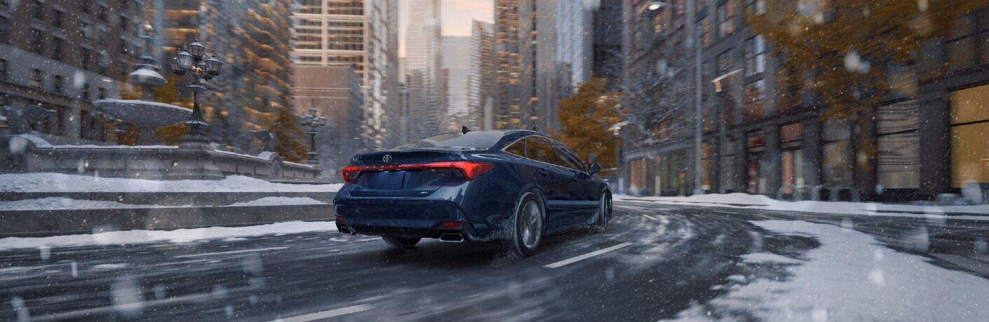 2021 Toyota Avalon driving through a snowy city