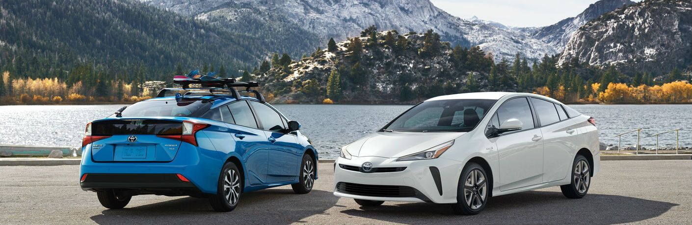 Two 2021 Toyota Prius models by water
