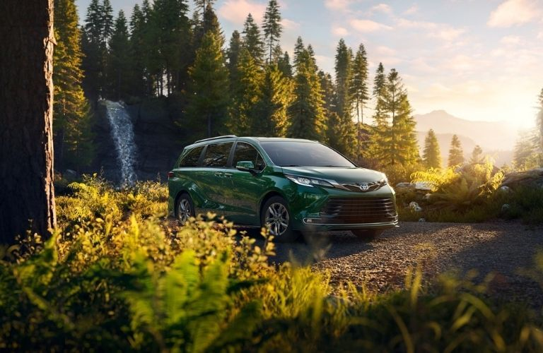 2021 Toyota Sienna Cypress parked in the middle of the forest during daytime