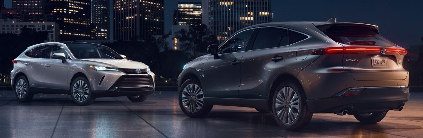 Two 2021 Toyota Venza models in a city