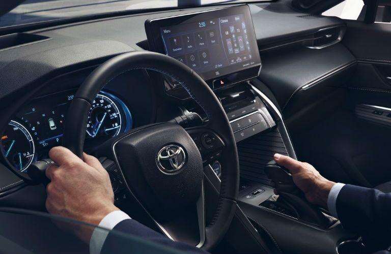Man manipulates control inside 2021 Toyota Venza