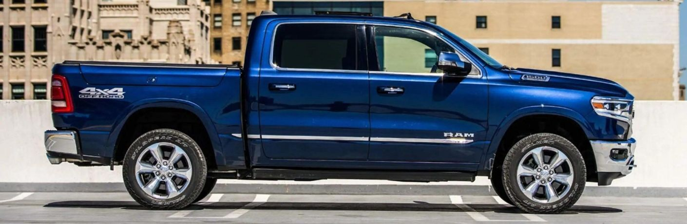 Hydro Blue Pearl RAM 1500 parked in front of a building