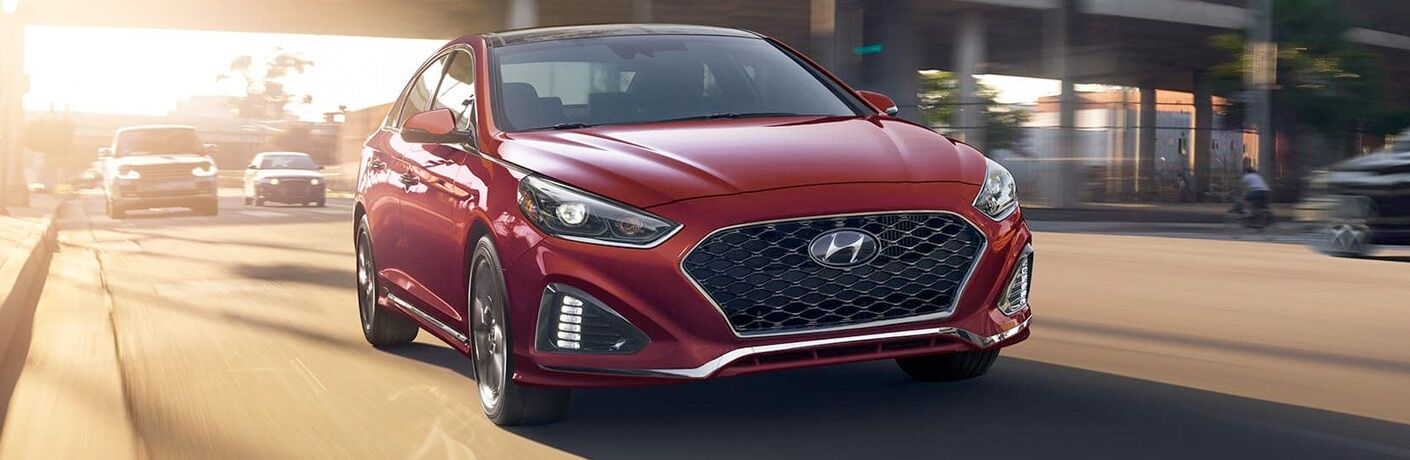 front view of a red 2019 Hyundai Sonata Hybrid