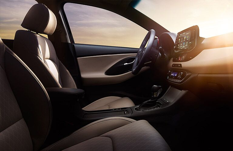 Interior front of the 2020 Hyundai Elantra with sunlight beaming through the windshield.
